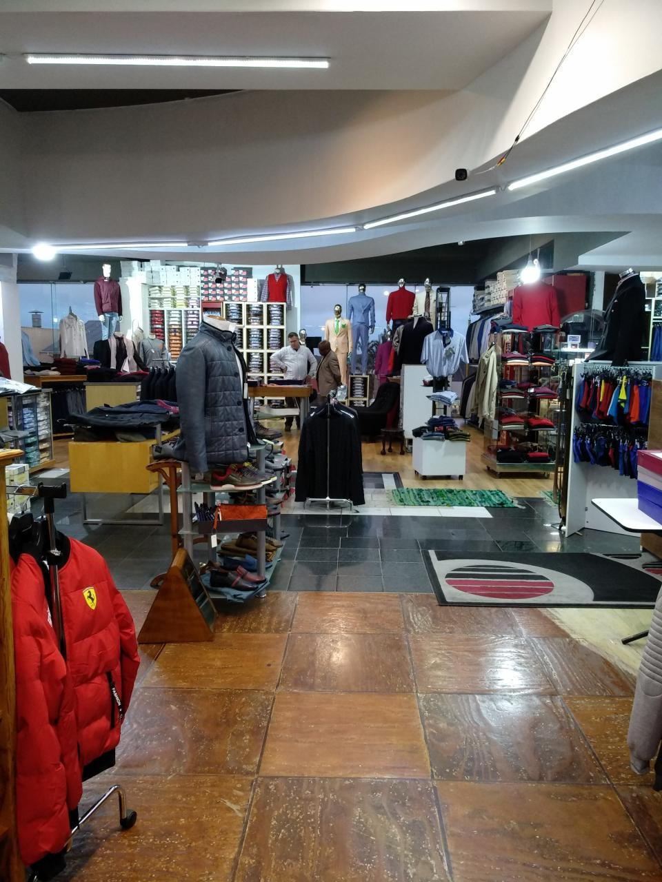 33 Yrs Established, Iconic, Men's Outfitters.