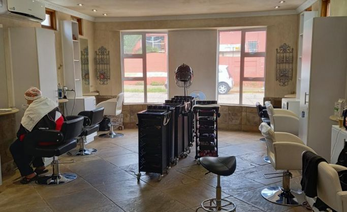 Hair dresser with retail sales of hair products